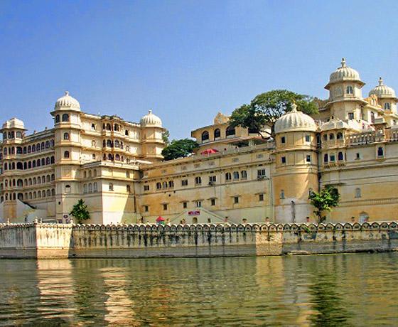Take a boat ride on Lake Pichola to view the Shiv Niwas Palace, Udaipur