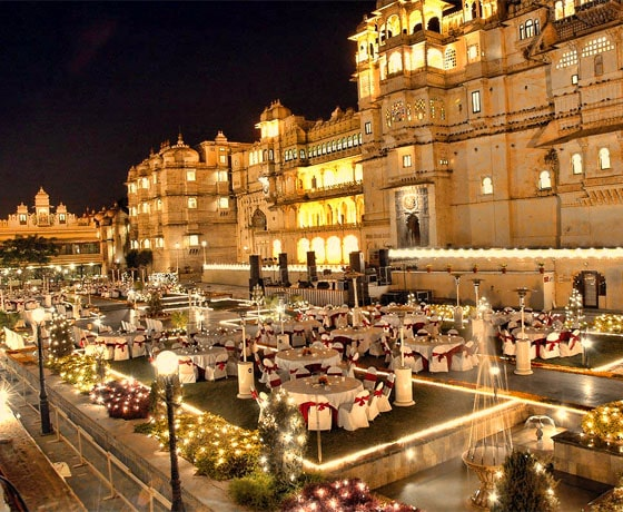 Wedding reception set up with a palace backdrop at Shiv Niwas Palace, Udaipur