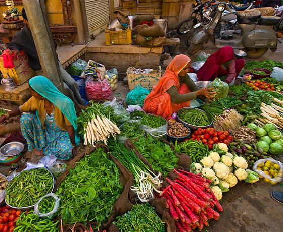 Rajasthani ladies selling fresh produce at the vegetable market in, Jaipur