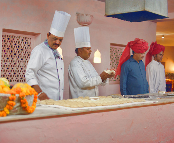 Our chefs demonstrating how naan the Indian bread is made. An evening at Skipper's County, Jaipur. We can organise cooking classes in this fabulous setting as well.