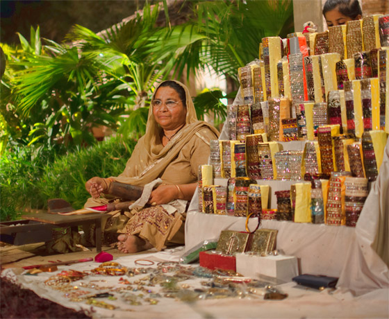 A local artisan selling lacquer bangles at the Gala evening at Skipper's County